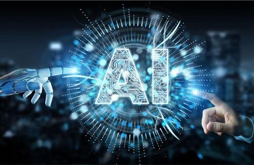 Zwei Hände und Schrift AI für Artificial Intelligence